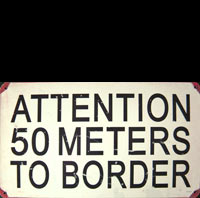 ATTENTION FRONTIERE 50 METERS TO BORDER FRONTIERE